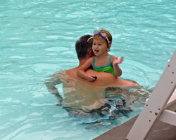 Child in Pool with Parent
